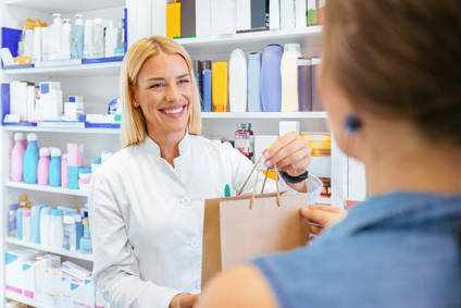 Pharmacist selling medications to pregnant customer